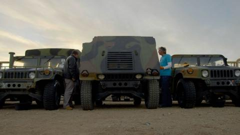 {S}13.{E}15. AM General Humvee